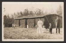 Ben Miller family outside of sod house