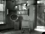Gramophone and chair inside settlement house